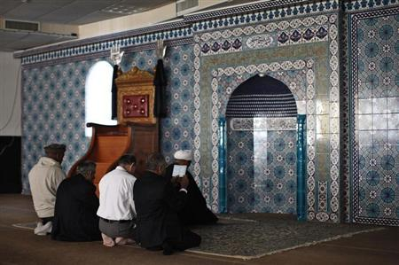 People pray at at the Imam al-Khoei Foundation in New York