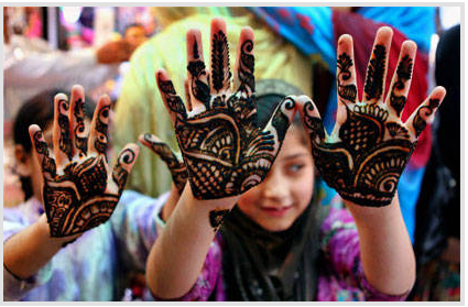 Muslim girl showing Henna